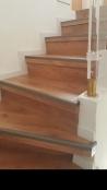 כיסוי מדרגות בפרקטים למינציה עם סף