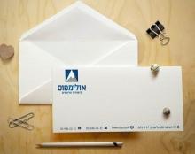 עיצוב מעטפה לחברת אולימפוס